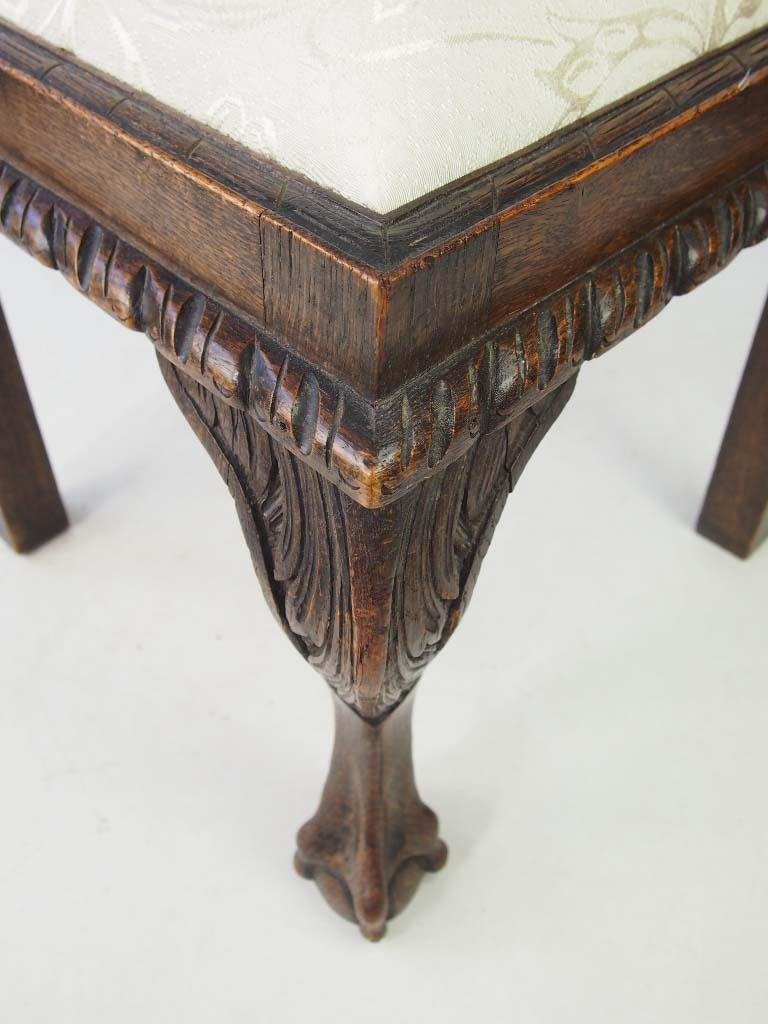 Victorian oak corner chair carved with moustachioed