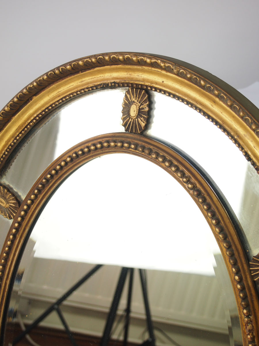 Antique gilt sectional oval wall mirror for Antique wall mirrors
